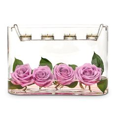 Luovuus Suorakaide -kynttiläsomiste   P91951   Puhalletusta lasista valmistettu alaosa, metallinen teline Tuikkiville. Korkeus 23 cm. (Telineessä: Tuikkiva)