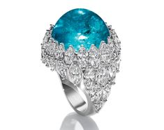 Harry Winston one-of-a-kind cabochon Paraiba tourmaline and diamond ring.  Love the color of that tourmaline.  K.