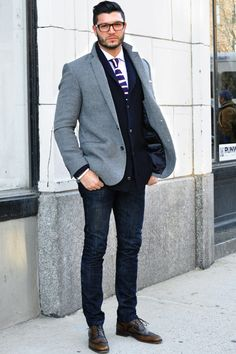 Dark blue jeans, navy cardigan, white shirt, tie, grey blazer, brown shoes. Causal outfit that's classy.