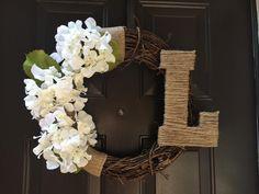 18 inch grapevine wreath with white hydrangeas and twine L custom made by awreathforyouca