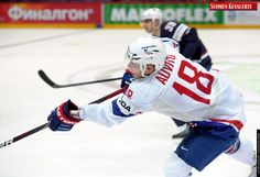Yohann Auvitu of France (F) makes a pass during the game USA vs France, the opener of the 2012 IIHF Ice Hockey World Championships in Helsinki