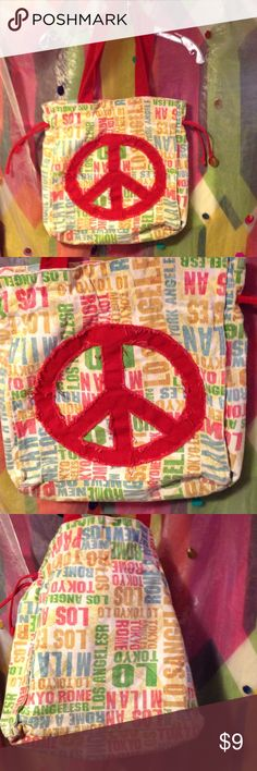 """X-Large Traveling Canvas """"Peace"""" Tote (Heavy Duty) This is an X-Large traveling tote made of thick canvas material. It's a very heavy duty tote too. Velcro closure, zipper closure inside the tote with 2 other side compartments. *YHERE ARE NO RIPS TEARS HOLES ANYWHERE ON THIS TOTE!* INSIDE BAG HAS A GREEN STAIN. From what? It was a school bag and a travel bag! The height is: 15"""" Length is: 13"""" Strap Drop: 23"""" Depth: 13"""" EXCELLENT TRAVELING TOTE AND CAN HOLS A LOT OF WEIGHT!! Unknown Bags…"""