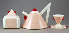 """""""Nefertiti"""" ceramic tea set for Memphis-Milano by Matteo Thun. Sugar bowl, teapot and cup. In red/white or gray/gold."""