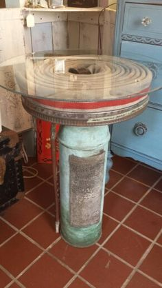 Repurposed fire hose and extinguisher turned side table. (like the hose idea, the extinguisher not so much) Firefighter Room, Firefighter Crafts, Firefighter Equipment, Firefighter Quotes, Fire Hose Projects, Fire Hose Crafts, Into The Fire, Fire Dept, Fire Extinguisher