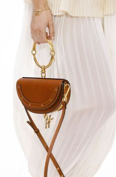 For the past year, Chloe has once again revolutionized the fashion industry with the introduction of their signature Chloe handbags, the Paddington and the Silverado. Chloe Nile Bag, Chloe Bag, Fashion Handbags, Fashion Bags, Fashion Accessories, Paris Fashion, Best Designer Bags, Chloe Handbags, Bags 2017