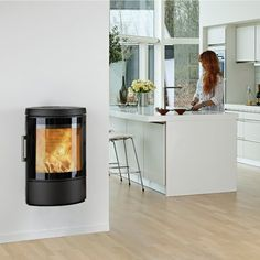 Beautifully curved this fire with its large glass door can be sat on a hearth or wall mounted. Foyers, Modern Stoves, Wood Pellet Stoves, Wood Store, Wood Pellets, Curved Glass, Wood Burner, Glass Door, Modern Interior