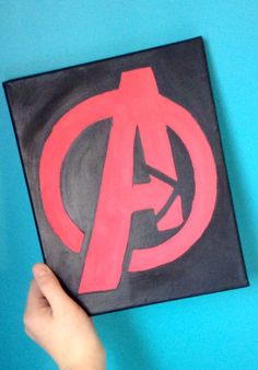 Just finished my latest project- Marvel's Avengers logo painted on canvas – Visi… Just finished my latest project- Marvel's Avengers logo painted on canvas – Visit to grab an amazing super hero shirt now on sale! Simple Canvas Paintings, Small Canvas Art, Mini Canvas Art, Super Hero Paintings, Logo Marvel, Marvel Art, Marvel Avengers, Marvel Canvas Art, Superhero Canvas