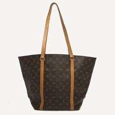 Louis Vuitton Shopping Sac Monogram Canvas Mm Brown Tote Bag. Get one of the hottest styles of the season! The Louis Vuitton Shopping Sac Monogram Canvas Mm Brown Tote Bag is a top 10 member favorite on Tradesy. Save on yours before they're sold out!