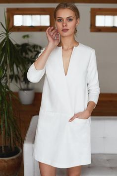 Mod Dress - White A inspired, modern-classic shift dress. Wear this on its own for an easy, polished look or layered over denim for a more casual look. Features a sleeve, front pocket details and hook + eye neckline closure. Cotton Twill Made Mode Outfits, Dress Outfits, Casual Dresses, Fashion Dresses, Simple Dress Casual, White Dress Casual, Simple White Dress, Hijab Dress, Edgy Dress