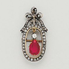 Ruby, Diamond, Silver and 14K Gold Pendant/Brooch   1 pear shaped ruby of approx 0.95 ct, 1 old mine-cut and 62 (+1 deficient) rose-cut diamonds, measuring 1 3/16 ins by 9/16 in