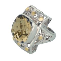 Coronation Day (CD005) Arrive in style with this graceful square 925 sterling silver ring set with a yellow topaz centrepiece decorated with eight 18k gold circles.