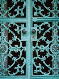 Turquoise wrought iron doors - gorgeous!