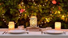 A lace sleeve around an illuminated mason jar creates a magically lovely lantern for outdoor events... or indoor ones.