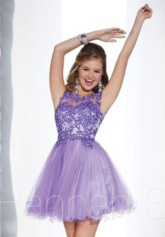 This flirty Hannah S prom dress will have you stand out above the rest with its trendy lace high neckline and tulle skirt. The top is embellished in gorgeous lace that is becoming a popular style for the 2014 prom season. Turn heads wherever you go as you reveal a stunning open back that is sure to make you the center of attention. Style 27845 is perfect for wearing as a short prom dress, homecoming dress, or bat mitzvah dress.