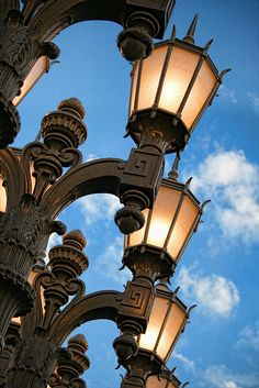 """LACMA's unique """"Urban Light"""" sculpture by Chris Burden is a display of two-hundred and two restored cast iron antique street lamps. Lantern Post, Lantern Lamp, Candle Lanterns, Antique Lamps, Vintage Lamps, Light Of The World, Street Lamp, Kerosene Lamp, Outdoor Lighting"""
