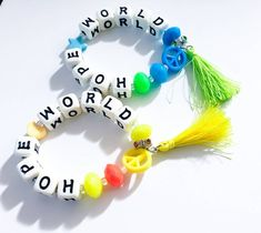 This colorful, chunky beaded stretch bracelet is inspired by an accessory seen on J-Hope (Jung Hoseok) during the filming of his video Chicken Noodle Soup Bts Bracelet, Beaded Bracelets, Pulseras Kandi, Murakami Flower, Kpop Diy, Cute Patches, Hello To Myself, Diy Stickers, Pony Beads