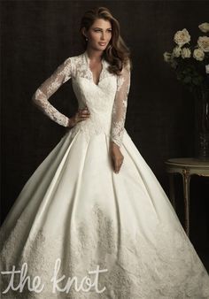 Kinda looks like Princess Kate Middleton's weding dress. Gotta love it :) So classy! Gown features lace.