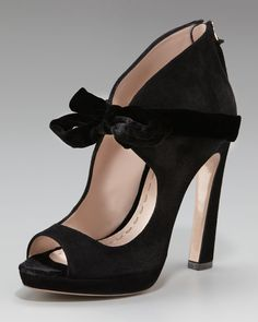 Miu Miu  Velvet-Bow Victorian Pump is a perfect pair with your holiday party dress.