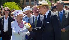 "Prince Philip ""got flowers from a young girl in the crowd and walked across to give them to the Queen.  She looked up at him with a look of love, as if she was seeing him for the first time again."" I LOVE this photo!!"