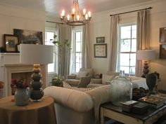 Living Room features CR Laine's Chichester Chesterfield Sofa in a fabric from Sunbrella. Image via Donna's Blog - A Designer's Perspective