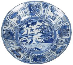 A Chinese Kraak porcelain charger decorated with ducks. Wanli period. Very large blue & white charger decorated with ducks in a landscape. On the rim, panels with auspicious objects.