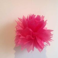How to make a tissue paper pom pom via @Guidecentral - Visit www.guidecentr.al for more #DIY #tutorials paper craft, papercraft, tissu paper, paper pom poms, diy craft, diy flower, crafti flower, diy projects, discov diy