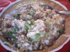 Bubur Ayam Campur Sayuran. Chicken Porridge with vegetable.