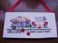 VINTAGE COMPLETED CROSS STITCH OF A CARAVAN