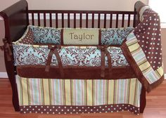Blue, Brown, and Green Crib Set  This custom bedding set includes the bumper, blanket and stripe with polka dot border crib skirt. The bumper features french blue and chocolate damask, polka dots, green ultra soft minky, and stripe piping. The blanket is chocolate minky backed with a soft cuddle edge and the front coordinates the cotton polka dot and stripe fabrics.