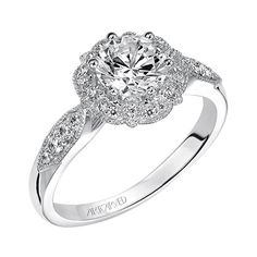 Francesca is a milgrain Halo engagement ring with diamond shank and milgrain borders.