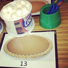transitional kindergarten or preschool game I made. print out pumpkin pies with numbers on them. use an empty container (playdough, etc.) affixed with a cool whip label printed on the Internet. children can use grippers to count the appropriate dollops of whip cream (cotton balls) onto the numbered pies.  #counting #thanksgiving #preschool #math #finemotor #grippers