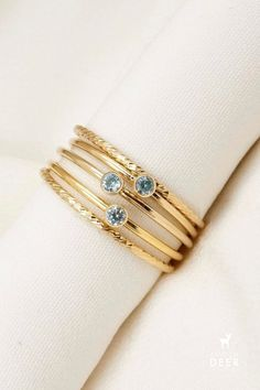 We love this dainty birthstone ring stack. March's birthstone is aquamarine, we love the blue hue. Aquamarine Birthstone Ring, Anniversary Present, Dainty Jewelry, Initial Necklace, Stacking Rings, Birthstones, Hue, Initials, Bracelets