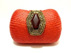 Bright, bold colors will be the rage this summer, and you won't find a hotter color than tangerine!  Add a burst of color to your look by incorporating this mini bag into your outfit! MIni Embellished Woven Bag by TONI & BERNE www.toniandberne.com