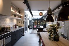 Cucina in stile industriale di BRICKS Studio