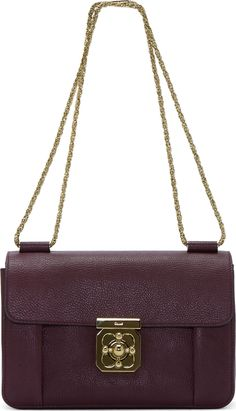 "Chloé Plum Leather Elsie Medium Shoulder Bag 42338F070041  Structured grained goatskin shoulder bag in plum. Gold-tone hardware. Modified rope chain shoulder strap. Foldover flap at main compartment with signature turn-lock closure. Pleat accents at front panel. Patch pocket at interior. Nude lambskin lining. Tonal stitching. Approx. 10"" length x 7"" height x 4"" depth. Goatskin, lambskin. Made in Italy"