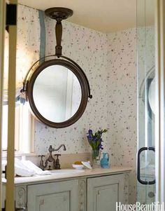 When a window left little room for an above-the-sink mirror in the guest bath of a Malibu home, designer Lawrence Rizkowsky looked up instead — mounting a shaving-style one from the ceiling.