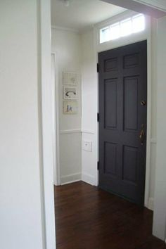 Dark Grey Door, White Trim, Dark Hardwood Flooring.  PAINT: Benjamin Moore Aura