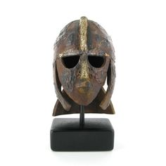 A bronze sculpture of the Sutton Hoo Helmet on display in the Museum's new Medieval gallery.