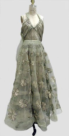 Evening dress Designer: Madeleine Vionnet (French, Chilleurs-aux-Bois 1876–1975 Paris) Date: 1939 Culture: French Medium: silk, metallic