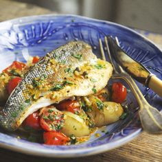 Gourmet Italian got easy! This dinner idea is Pan-Fried Sea Bass with Cherry Tomato Caponata. All you do is slice and boil some new potatoes, fry off some cherry tomatoes with onion, garlic, capers, vinegar and a bit of sugar then toss it all together before topping with your fish. For more quick recipe inspiration head over to www.the60secondchef.com #italianfood #glutenfree