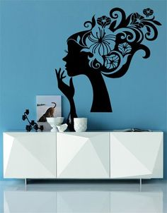 A gorgeous and stylish 'Floral Lady' decal to stylize the look of any boring home or salon wall!    Get it only on http://www.gloob.in/floral-lady.html