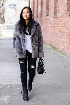 The Best Coats We've Spotted This Winter #refinery29  http://www.refinery29.com/san-francisco-coat-winter-street-style#slide-9  Kate Ogata of The Fancy Pants Report cozies up in a faux fur Forever 21 coat.