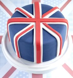 Union Jack Cake: Get patriotic with Union Jack cake using Renshaw red, white and blue ready to roll icings at www.mybakes.co.uk