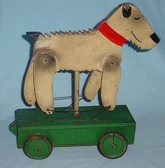 Fox Terrier on platform wheeled toy