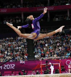 American gymnast Gabby Douglas performing split leap on balance beam at 2012 Summer Olympics in London, England.