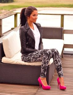 Black leather jacket, white flowy shirt, printed black and white skinnys, and pink stilletos. :)