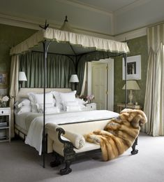 Love that fur throw and the antique chaise at the end of a beautiful poster bed.