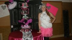 This amazing cake was a true labor of love. It was for my daughters sweet 16 party. It is all edible except the feathers. The purses, buttons, make up all the little things are made of edible materials! It was over 5 feet tall!