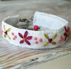 Embroidered Bracelet Pink and Green on White by Sidereal on Etsy.