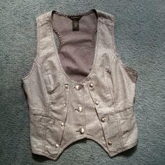 Rocawear Vest Silver button down vest. Never worn  Dress it up or down! Do whatever you want, it's yours now Rocawear Jackets & Coats Vests